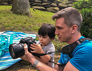 Dr. Andrew Elliston teaching child to use a camera